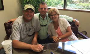 The Parkers with Ryan Boone at the closing of their new ITB home purchase
