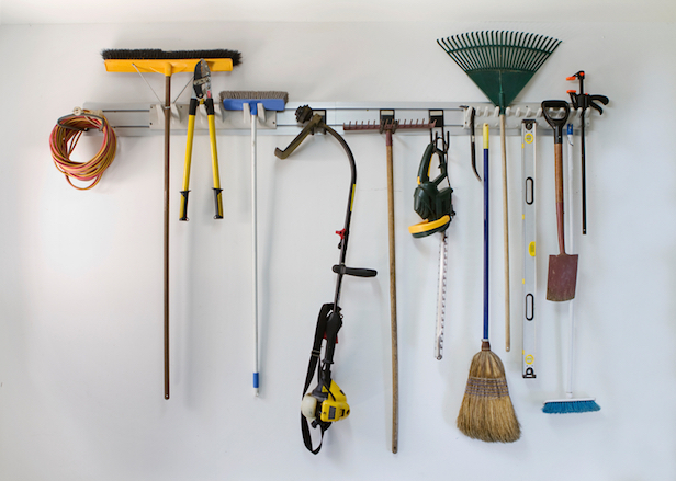 Neat garage tools hanging on a storage rack